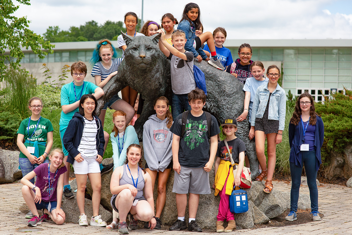 group of children posing with UNH Wildcat statue