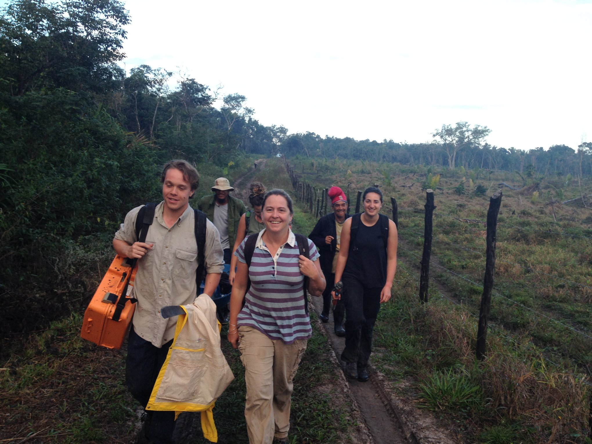 students and faculy walking to excavation site