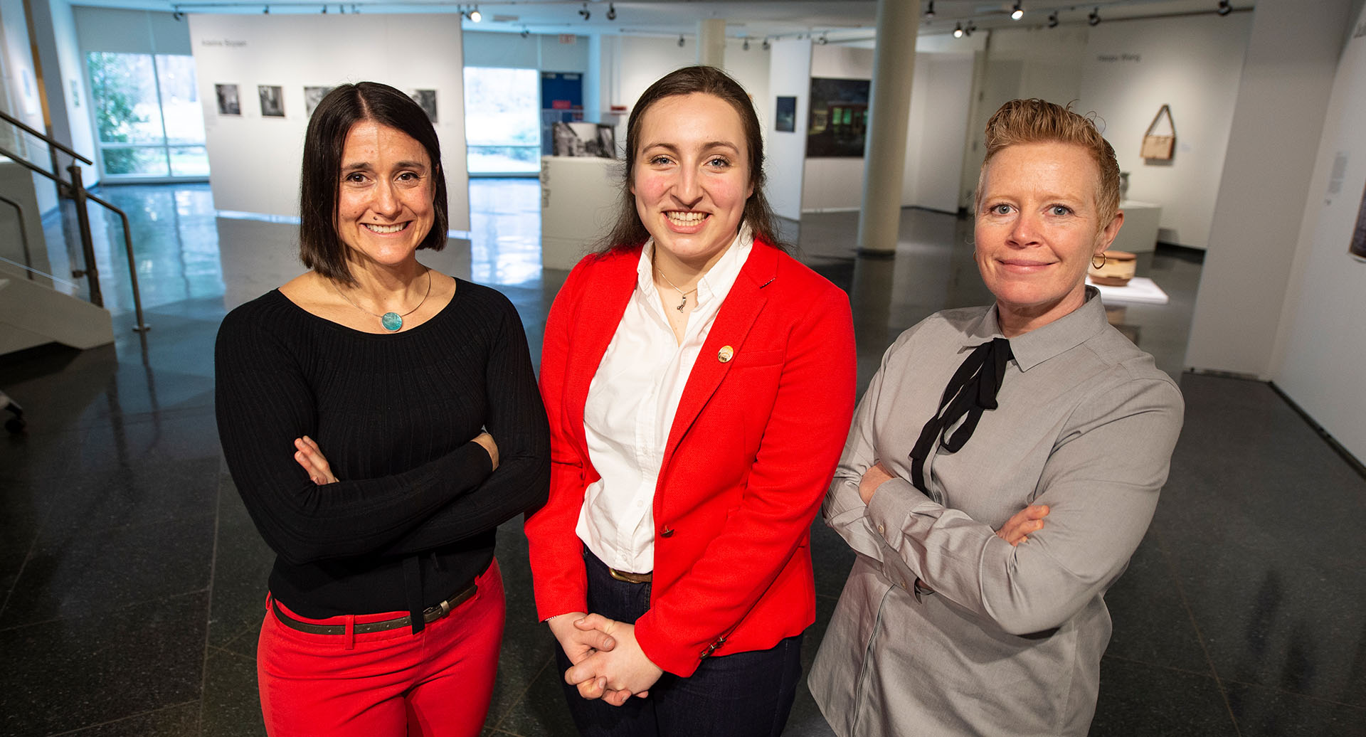 photo of Megan Cooper in the Museum of Art with staff