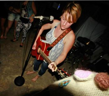 Hannah Peckham playing guitar