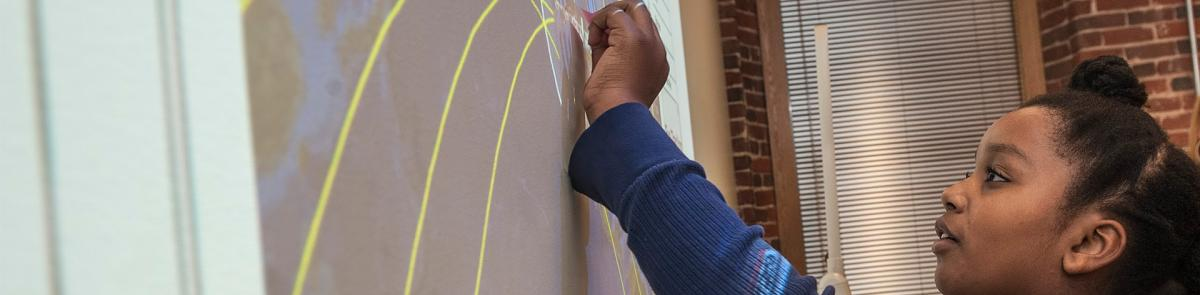 Education Student using a SMART Board