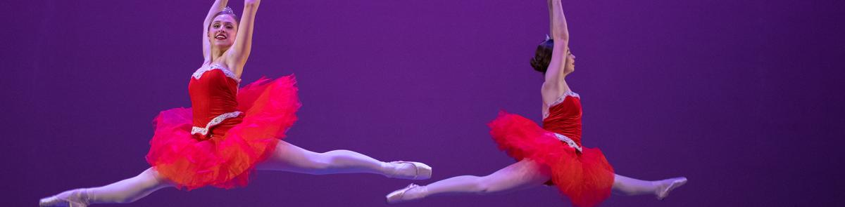 Dance students in red ballet dresses