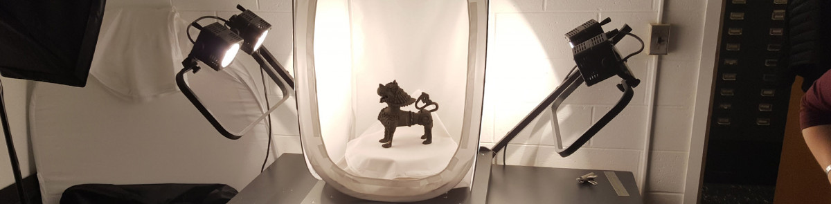 photo of statuette under lights