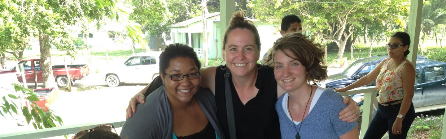 photo of Prof Harrison Buck in Belize with students and community members