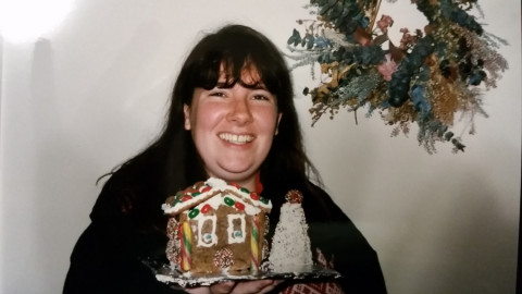 Woman with a Gingerbread House