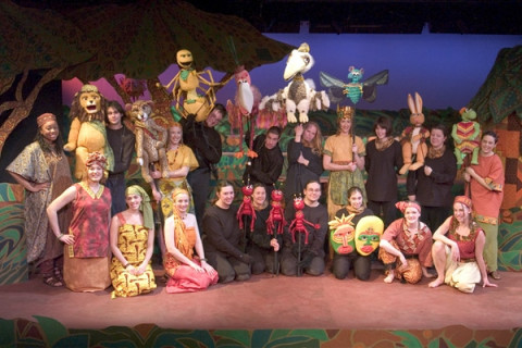 student actors and puppets on stage