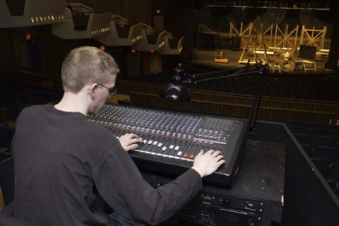 student at lighting panel