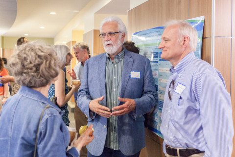 People discussing poster presentations