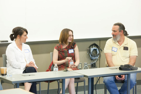 Panelists at a table