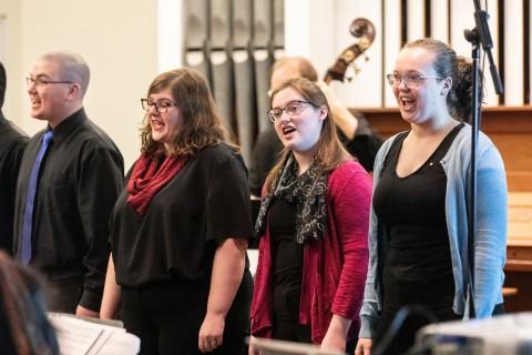 four people singing