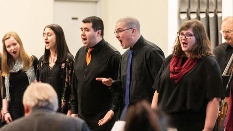 men and women singing