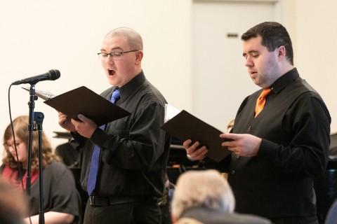 two men singing