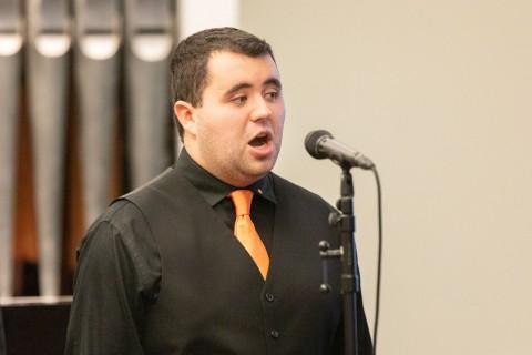 man singing with mic