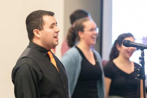man smiling and singing