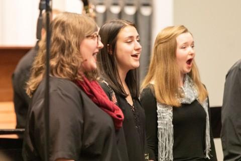 three women singing
