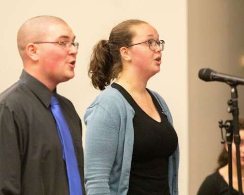 man and woman singing