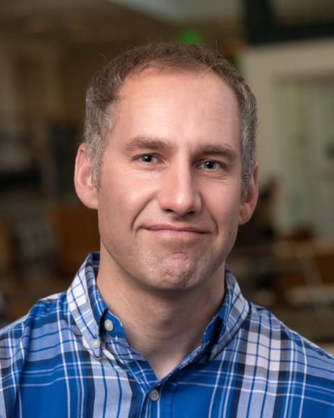 headshot of Adam Schoene