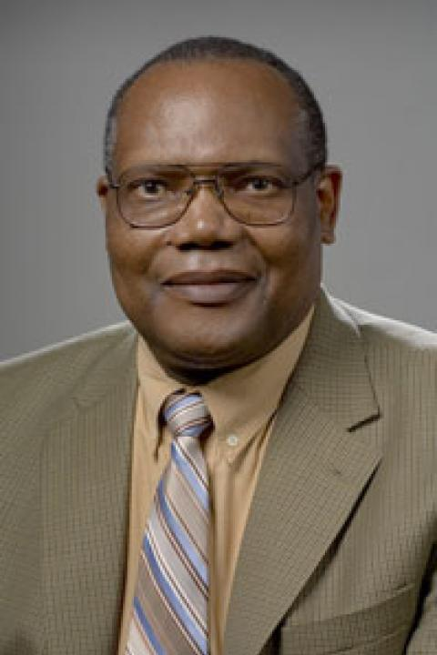 headshot of Justus Ogembo