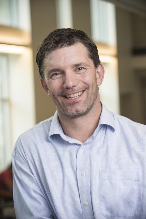 headshot of Thomas Higginbotham