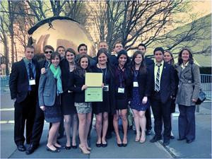 COLA model UN students pose together