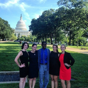 A group of interns participating in The Washington Center program pose in front of the White House in Washington, D.C.